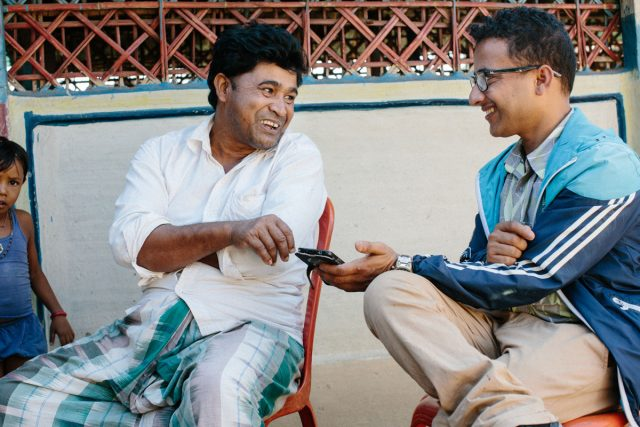 Leprosy doctor and person affected by leprosy laughing together