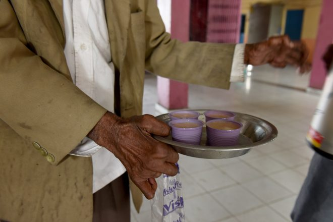Chai tea served by a person affected by leprosy