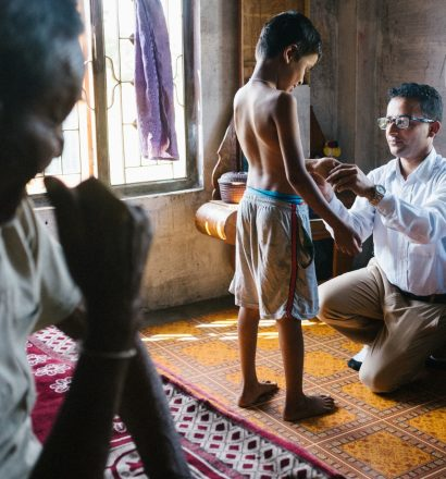 Leprosy doctor checks his patient on symptoms of leprosy