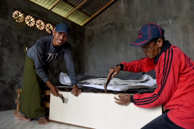 Person affected by leprosy Mohammed with his father working together